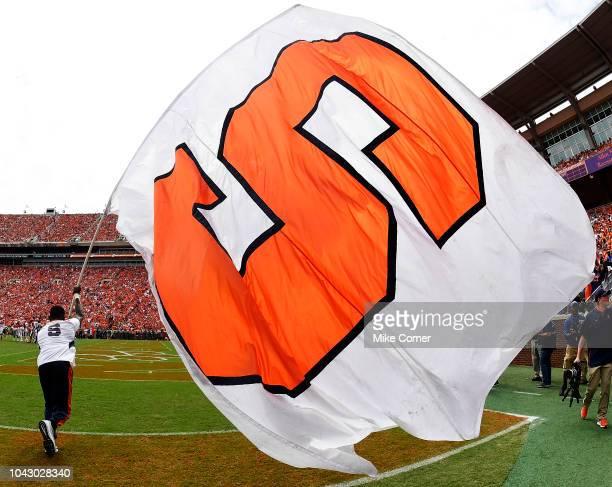 Syracuse Orange cheerleader waves a giant Orange flag during their football game against the Clemson Tigers at Clemson Memorial Stadium on September...