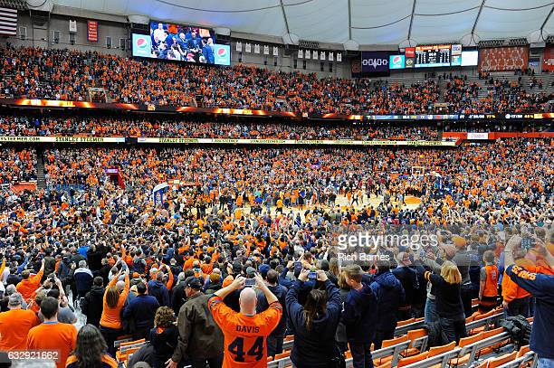 Syracuse Orange fans rush the court following the game against the Florida State Seminoles at the Carrier Dome on January 28 2017 in Syracuse New...