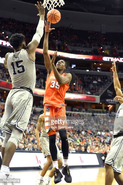 Syracuse Orange forward Bourama Sidibe shoots over Georgetown Hoyas center Jessie Govan on December 16 at the Capital One Arena in Washington DC The...