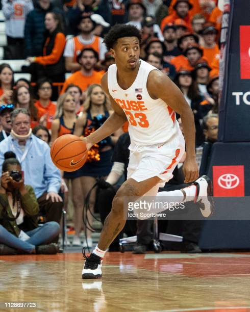 Syracuse Orange Forward Elijah Hughes dribbles the ball up the court during the first half of the game between the Virginia Cavaliers and the...