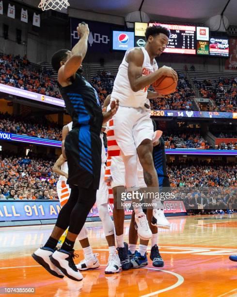Syracuse Orange Forward Elijah Hughes grabs a rebound with Buffalo Bulls Guard CJ Massinburg during the first half of the Buffalo Bulls versus the...