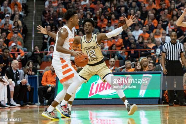 Syracuse Orange Forward Elijah Hughes looks to pass the ball with Georgia Tech Yellow Jackets Forward Khalid Moore defending during the first half of...