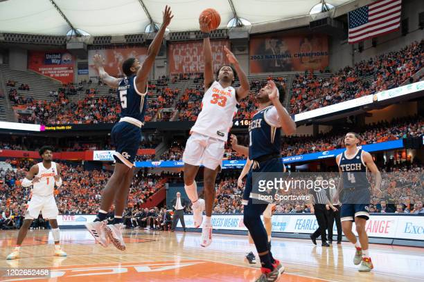 Syracuse Orange Forward Elijah Hughes shoots a layup with Georgia Tech Yellow Jackets Forward Mmoses Wright and Georgia Tech Yellow Jackets Forward...