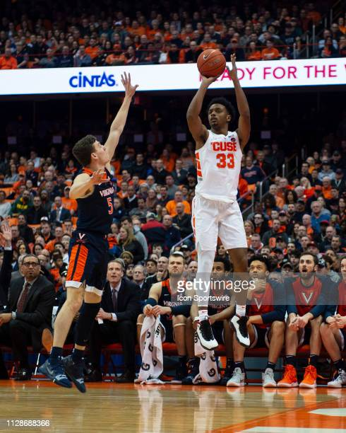 Syracuse Orange Forward Elijah Hughes shoots a three point jump shot with Virginia Cavaliers Guard Kyle Guy defending during the first half of the...