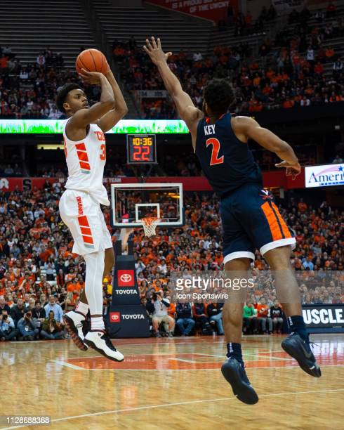 Syracuse Orange Forward Elijah Hughes shoots a three point jump shot with Virginia Cavaliers Guard Braxton Key defending during the first half of the...