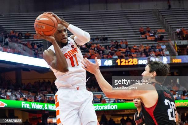 Syracuse Orange Forward Oshae Brissett grabs an offensive rebound with Northeastern Huskies Guard Bolden Brace defending during the second half of...