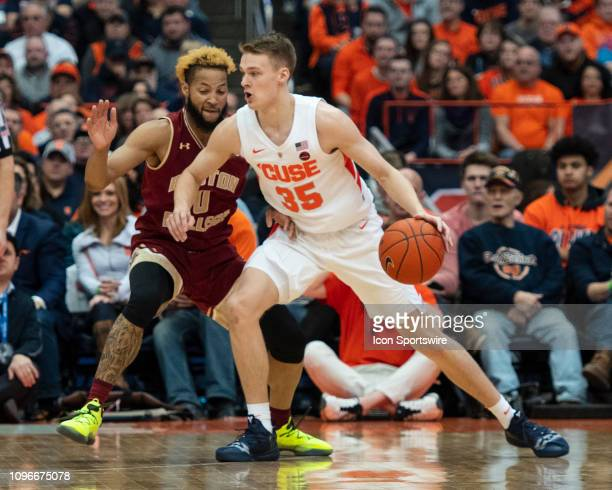 Syracuse Orange Guard Buddy Boeheim dribbles the ball against Boston College Eagles Guard Ky Bowman during the first half of the Boston College...