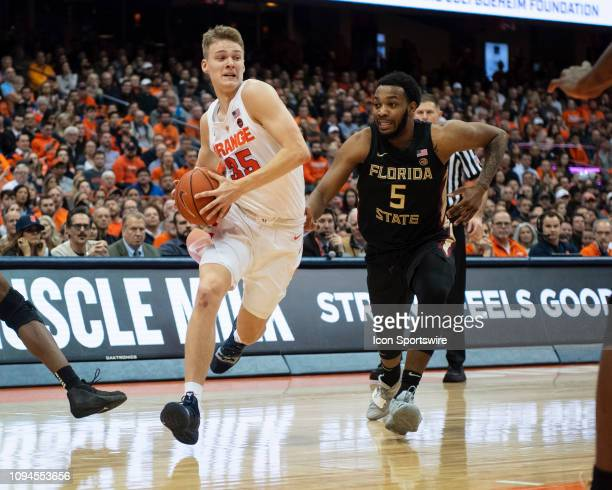 Syracuse Orange Guard Buddy Boeheim drives the ball toward the basket with Florida State Seminoles Guard PJ Savoy defending during the second half of...