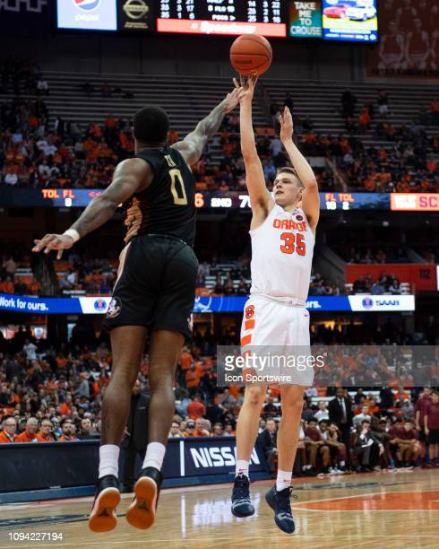 Syracuse Orange Guard Buddy Boeheim shoots a jump shot over Florida State Seminoles Forward Phil Cofer defending during the second half of the...