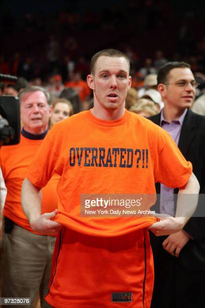 Syracuse Orange guard Gerry McNamara slips on an Overrated Tshirt after the Orange defeated the Pittsburgh Panthers 6561 in the Big East Championship...
