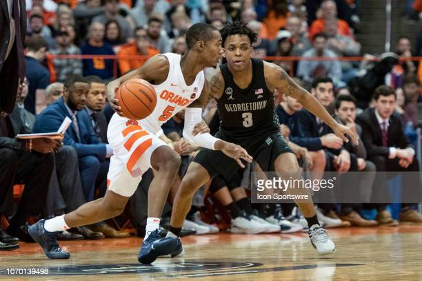 Syracuse Orange Guard Jalen Carey dribbles the ball against Georgetown Hoyas Guard James Akinjo defending during the first half of the Georgetown...