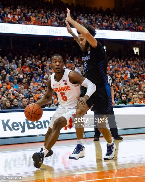 Syracuse Orange Guard Jalen Carey dribbles the ball toward the basket with Buffalo Bulls Guard Jeremy Harris defending during the second half of the...