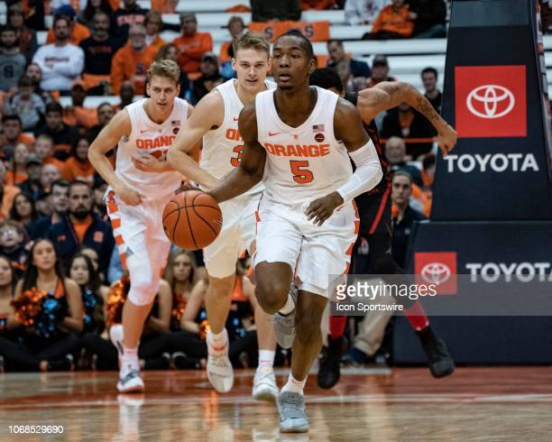 Syracuse Orange Guard Jalen Carey dribbles the ball up the court on a break during the second half of the Northeastern Huskies versus the Syracuse...