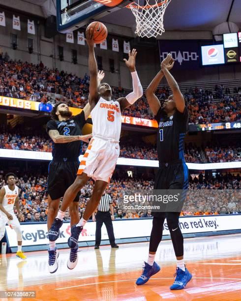 Syracuse Orange Guard Jalen Carey shoots a layup with Buffalo Bulls Guard Jeremy Harris and Buffalo Bulls Forward Montell McRae defending during the...