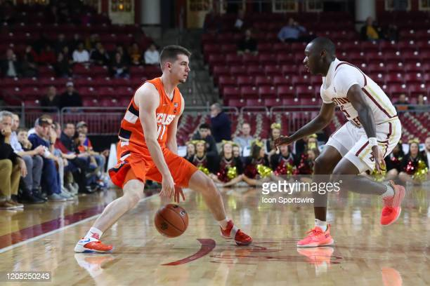 Syracuse Orange guard Joseph Girard III bounces the ball away from the defender during the game between Boston College and Syracuse on March 3 at...