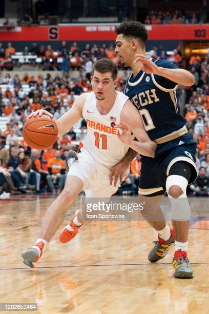 Syracuse Orange Guard Joseph Girard III dribbles the ball against Georgia Tech Yellow Jackets Guard Michael Devoe during the first half of the...