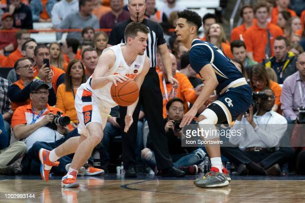 Syracuse Orange Guard Joseph Girard III dribbles thee ball against Georgia Tech Yellow Jackets Guard Michael Devoe during the second half of the...