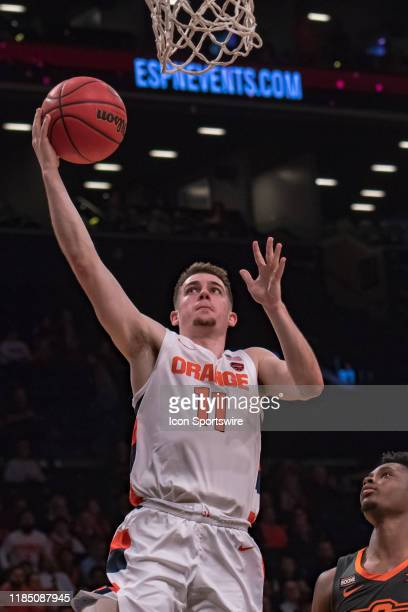 Syracuse Orange guard Joseph Girard III drives to the basket during the second half of the NIT Season TipOff semifinal round game between the...