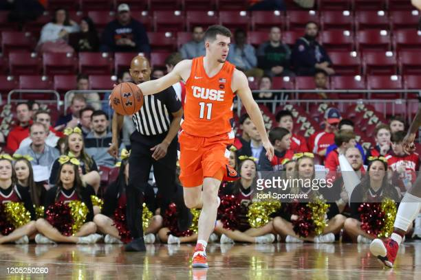 Syracuse Orange guard Joseph Girard III looks for a receiver during the game between Boston College and Syracuse on March 3 at Conte Forum in...