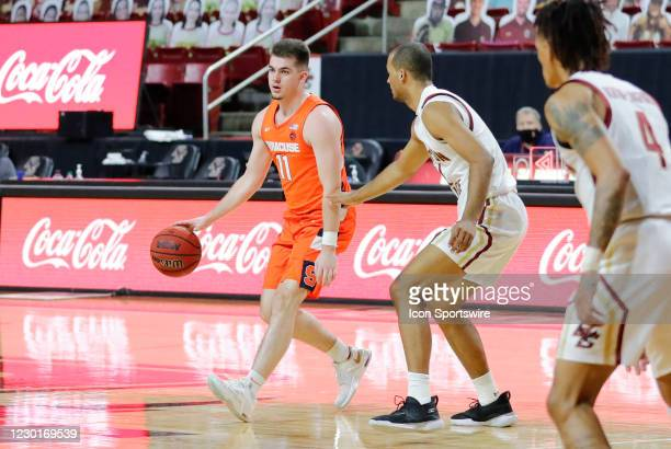 Syracuse Orange guard Joseph Girard III looks for help guarded by Boston College forward Steffon Mitchell during a game between the Boston College...
