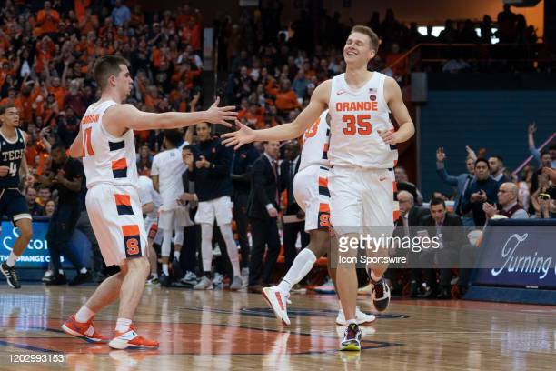 Syracuse Orange Guard Joseph Girard III slaps hands with Syracuse Orange Guard Buddy Boeheim for scoring a basket during the second half of the...