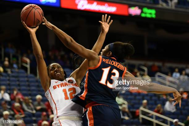 Syracuse Orange guard Kiara Lewis shoots against Virginia Cavaliers guard Jocelyn Willoughby during the ACC Women's basketball tournament between the...