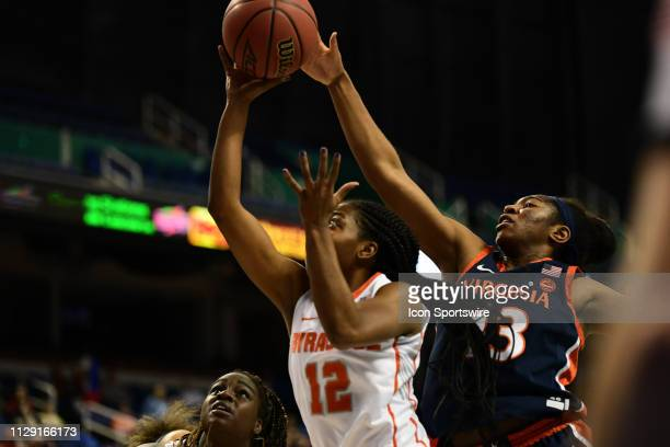 Syracuse Orange guard Kiara Lewis shoots the ball with Virginia Cavaliers guard Jocelyn Willoughby trying to block from behind during the ACC Women's...