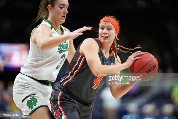 Syracuse Orange guard Tiana Mangakahia battles with Notre Dame Fighting Irish guard Marina Mabrey during the women's college basketball game between...