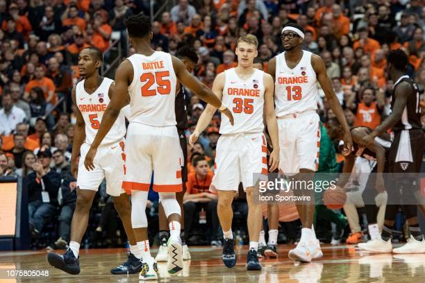 Syracuse Orange Guard Tyus Battle slaps hands with Syracuse Orange Guard Buddy Boeheim after he made a basket during the first half of the St...