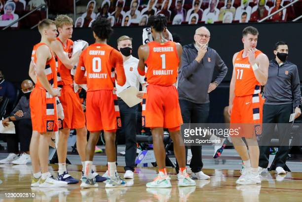 Syracuse Orange head coach Jim Boeheim and team wait through a replay during a game between the Boston College Eagles and the Syracuse Orange on...