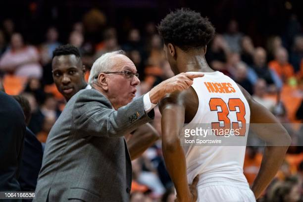 Syracuse Orange Head Coach Jim Boeheim speaks with Syracuse Orange Forward Elijah Hughes at a time out during the first half of the game between the...