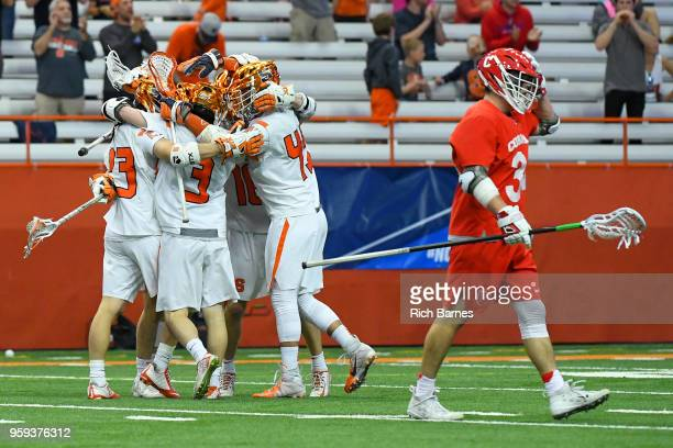 Syracuse Orange players celebrate a goal as Jake Pulver of the Cornell Big Red reacts during a 2018 NCAA Division I Men's Lacrosse Championship First...