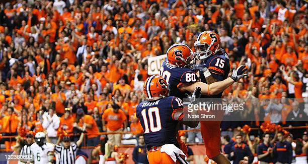Syracuse Orange players Dorian Graham and Nick Provo celebrate after a touchdown by Alec Lemon during the game against the South Florida Bulls at the...