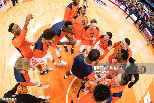 Syracuse Orange players huddle up before the game against the Cornell Big Red at the Carrier Dome on November 10 2017 in Syracuse New York