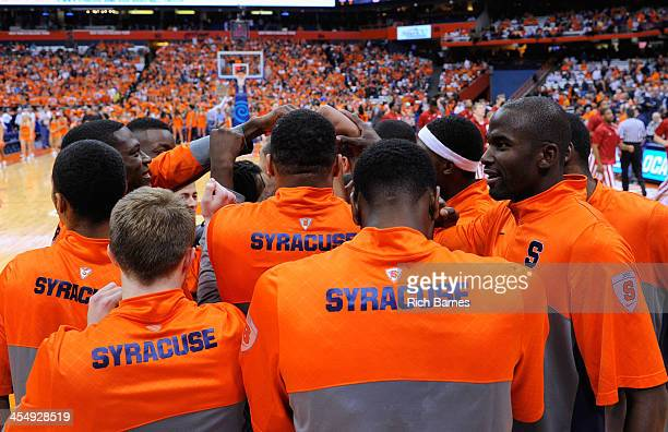 Syracuse Orange players meet prior to the game against the Indiana Hoosiers at the Carrier Dome on December 3 2013 in Syracuse New York Syracuse...