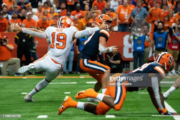 Syracuse Orange Quarterback Tommy DeVito is sacked by Clemson Tigers Safety Tanner Muse during the second quarter of the game between the Clemson...