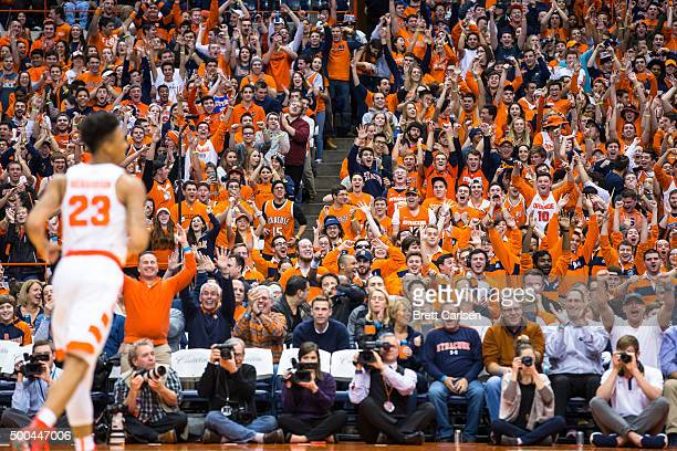 Syracuse Orange student fans react to a shot clock buzzer beater three point shot by Malachi Richardson of the Syracuse Orange during the first half...