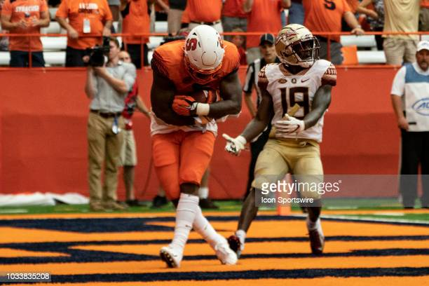 Syracuse Orange Tight End Ravian Pierce catches a pass for a touchdown with Florida State Seminoles Defensive Back AJ Westbrook defending during the...