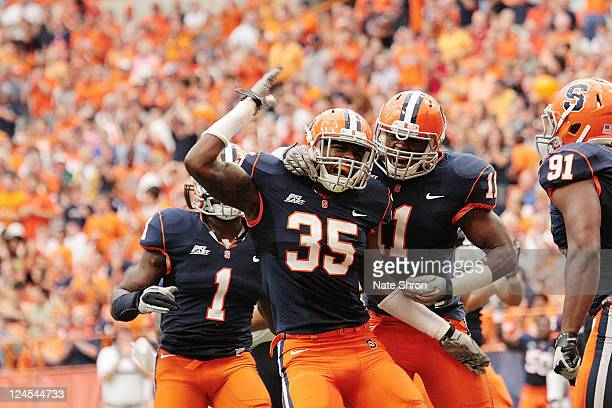 Syracuse players Dyshawn Davis and Phillip Thomas celebrate after a TD in the game against the Rhode Island Rams on September 10 2011 at the Carrier...