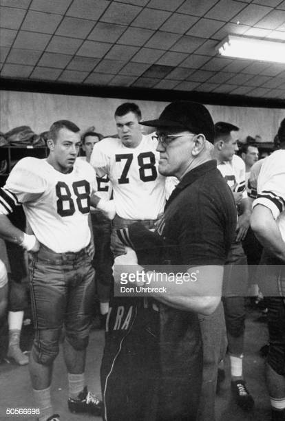 Syracuse Univ. Coach Floyd B. Schwartzwalder in locker room talking to players during Cotton Bowl game.
