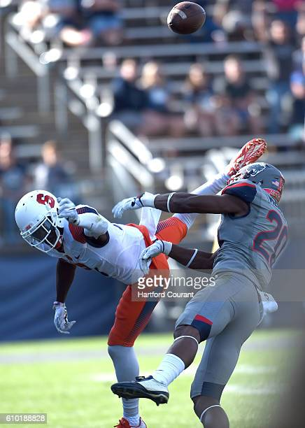 Syracuse wide receiver Ervin Philips and Connecticut safety Obi Melifonwu are unable to handle the onside kick in the final moments of the fourth...