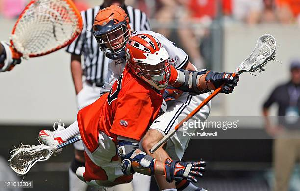 Syracuse's Dan Hardy is checked to the ground by Virginia's Drew Thompson in the Division I Lacrosse Semi-Finals Saturday, May 27, 2006 at Lincoln...