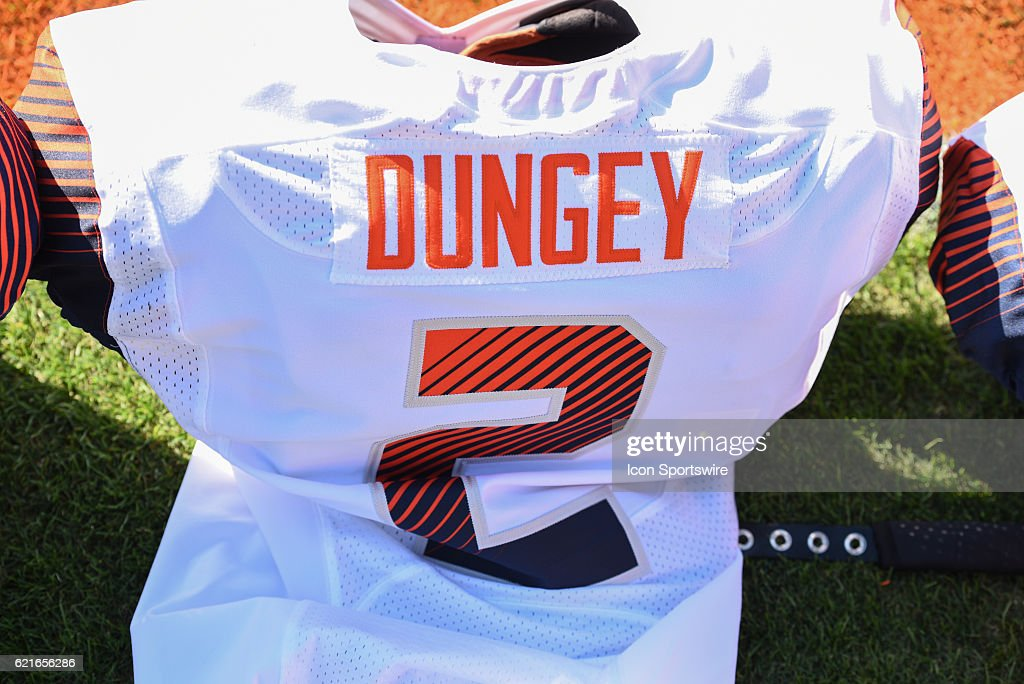 innovative design 5774a caa67 Syracuses Eric Dungey shoulder pads and jersey during pre ...