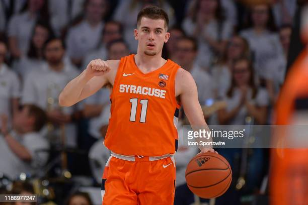 Syracuse's Joseph Girard III brings the ball up the court during the NCAA basketball game between the Syracuse Orange and the Georgia Tech Yellow...