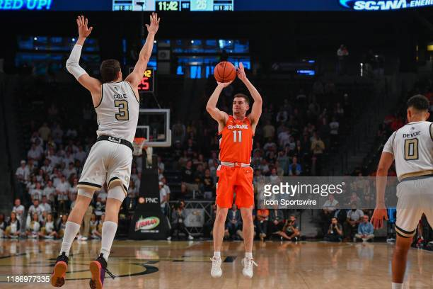 Syracuse's Joseph Girard III takes a three point shot during the NCAA basketball game between the Syracuse Orange and the Georgia Tech Yellow Jackets...
