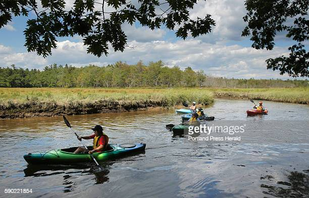 Syrah Arena of Massachusetts left and other kayakers paddle along the Little River estuary in the Wells National Estuarine Research Reserve on Monday...