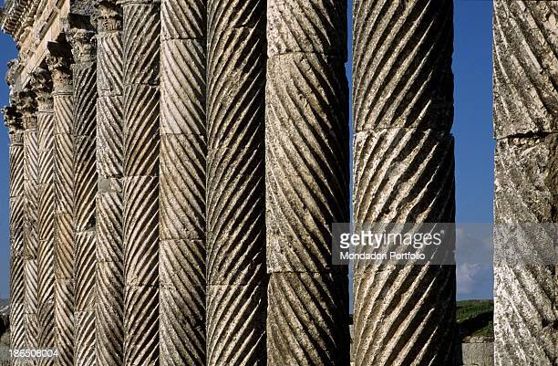 Syria Apamea Cardo Maximus Detail Fluted columns with Corinthian capitals with spiral grooves and marble decorations