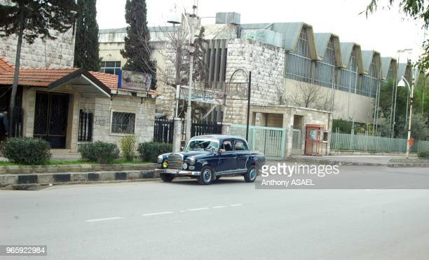 Syria Arab Republic Hama view of an oldfashioned Mercedes car on the street outside a house