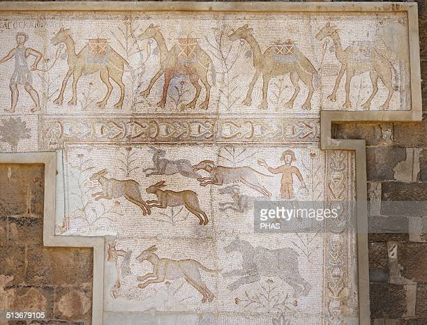 Syria Bosra Roman Mosaic of the theatre At the top a camel caravan and at the bottom a hunting scene