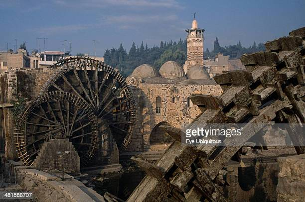 Syria Central Hama Wooden norias or waterwheels on the Orontes river and the AlNuri Mosque dating from 1172 and built of limestone and basalt